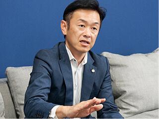 明電産業株式会社 代表取締役社長 毛塚 武久
